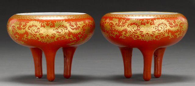 A pair of coral red and gilt enameled porcelain tripod bowls  Qianlong marks, Republic period
