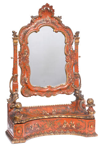 A Continental Rococo style parcel gilt and scarlet laquered dressing table mirror <BR />circa 1900