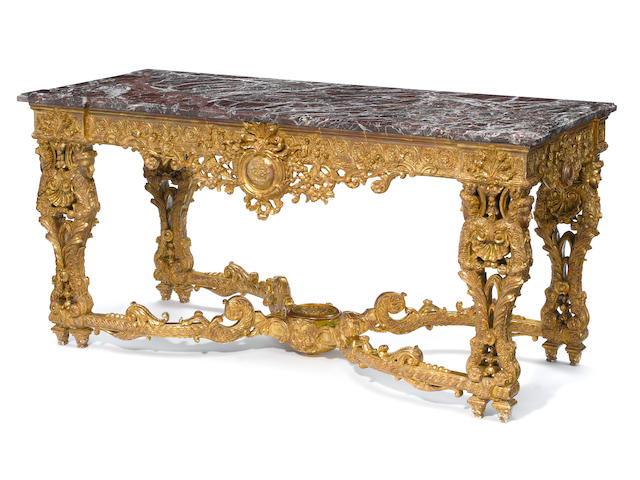 A Régence style giltwood console table with marble top