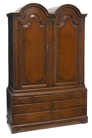 A George I walnut double domed top cabinet