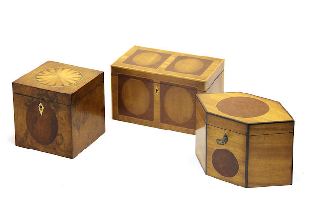 Three George III style inlaid mahogany tea caddies late 20th century