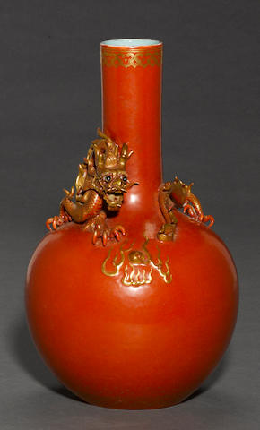 A coral red and gilt-enameled porcelain stick neck vase with applied dragon decoration Qianlong mark, Republic period