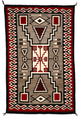 A Navajo storm pattern pictorial rug