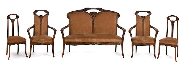 A Majorelle carved-mahogany five piece salon suite: Ombelles circa 1900