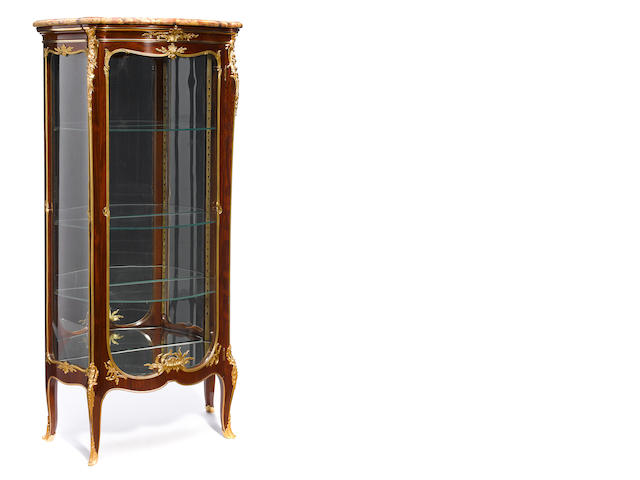 A Louis XV style gilt bronze mounted vitrine  <BR />attributed to François Linke