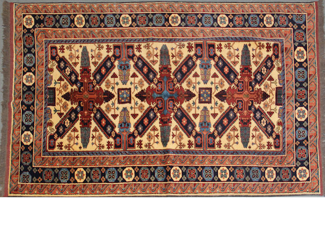 A carpet size approximately 4ft. 4in. x 6ft. 7in.