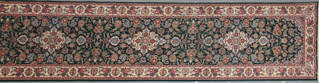 A Chinese carpet size approximately 2ft. 6in. x 14ft.