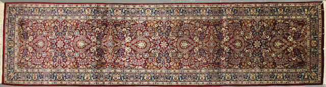 A Pakistani carpet size approximately 2ft. 6in. x 10ft.