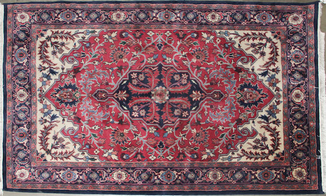 An Indian carpet size approximately 6ft. 1in. x 8ft. 9in.