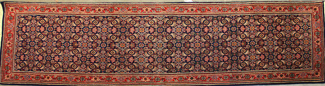 An Indian carpet size approximately 2ft. 6in. x 8ft.