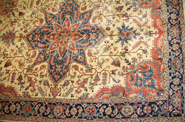A  Heriz design carpet size approximately 11ft. 6in. x 16ft. 6in.