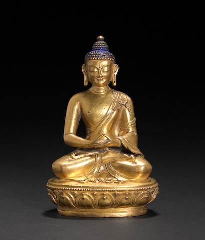 A Sino-Tibetan gilt copper alloy seated figure of the Buddha 18th/19th century