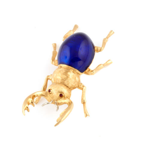 An enamel and 18k gold beetle brooch