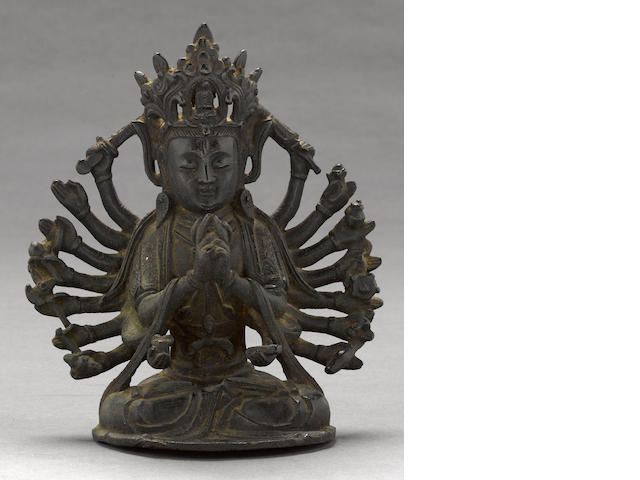 A cast bronze figure of Guanyin Ming dynasty