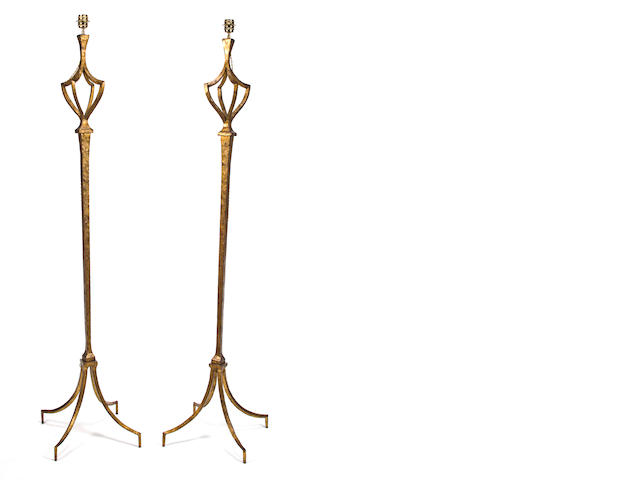 A pair of Maison Ramsay wrought and gilded iron floor lamp bases 1940's