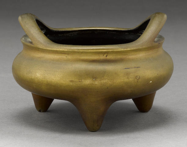 A bronze bombé form tripod censer Xuande Mark, 18th/19th century