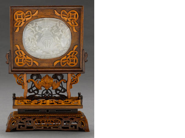 A mounted jade plaque with boxwood reticulated stand (jade 18th century?)