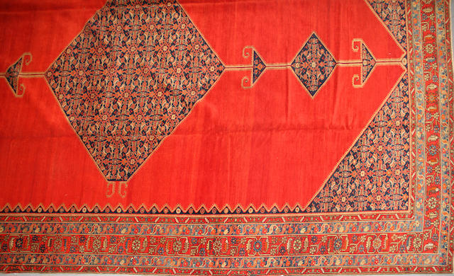 A Malayer carpet size approximately 11ft. 5in. x 17ft. 3in.