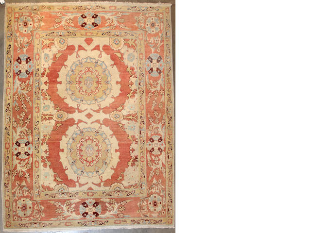 A Turkish carpet  size approximately 7ft. 11in. x 10ft. 1in.