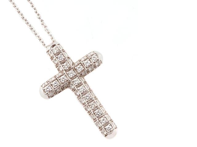 A diamond and 18k white gold cruciform pendant