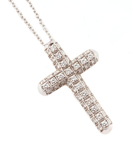 A diamond and 18k white gold cruciform pendant