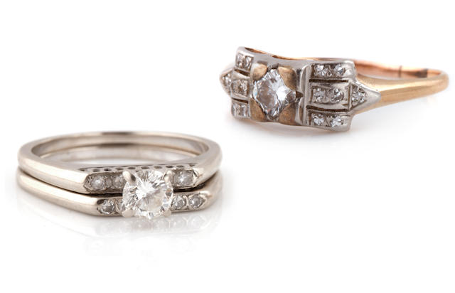A collection of three diamond and white gold rings