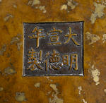 A fine 'sunspot' bronze tripod censer  Xuande mark, 18th century