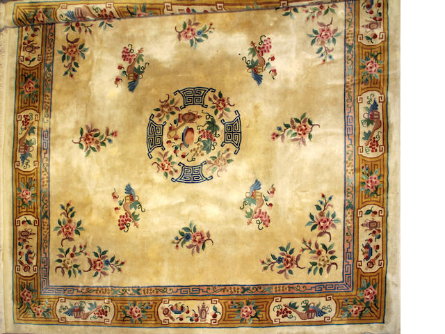 An Indo-Chinese carpet 14ft 6in x 10ft