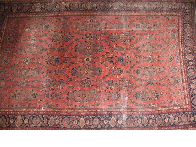 A Sarouk carpet size approximately 10ft. 6in. x 17ft. 2in.