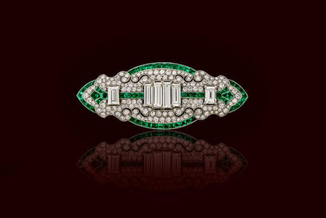 An art deco diamond and emerald brooch,