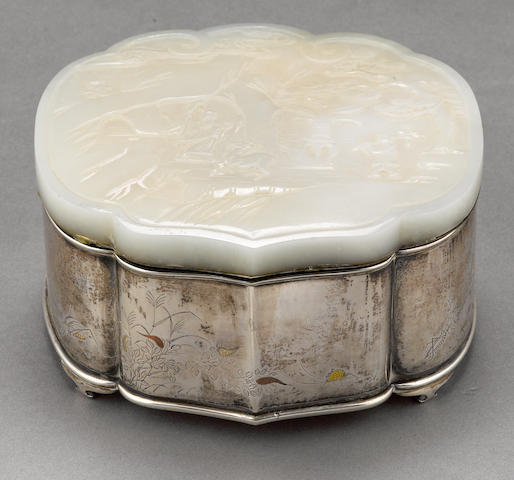 A white jade plaque mounted on a silver box  Late Qing dynasty