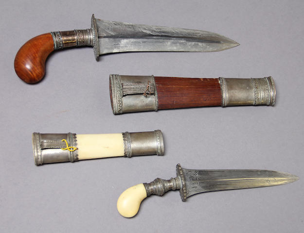 A lot of two silver-mounted Moro daggers, punal