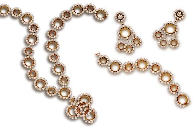 A diamond and eighteen karat gold suite, M. Gérard,