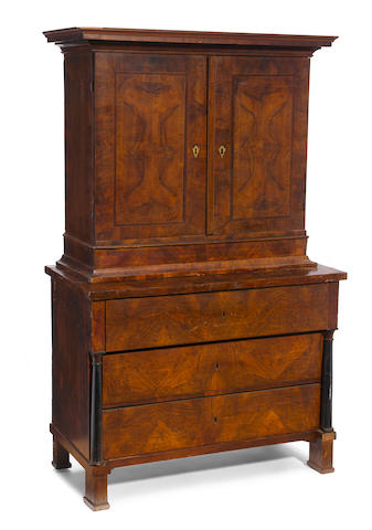 An Austrian Neoclassical parcel ebonized walnut cabinet