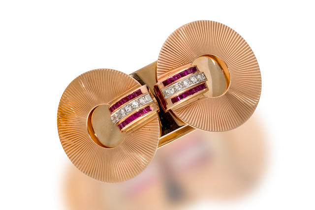 A retro fourteen karat bicolor gold, ruby and diamond bangle bracelet,