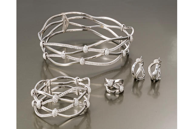 A suite of eighteen karat white gold and diamond jewelry