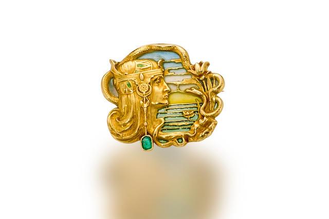 An art nouveau eighteen karat gold, enamel and emerald brooch, Joe Descomps,