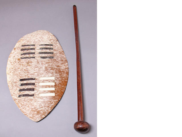A Zulu knobkerrie together with a later Zulu dance shield