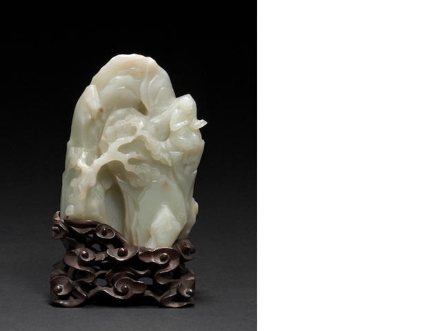 A pale greenish-white nephrite landscape boulder 17th/18th century