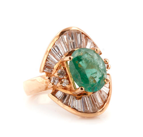 An emerald, diamond and gold ballerina ring