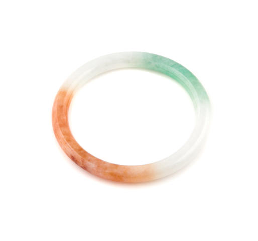 A multi-colored jade bangle
