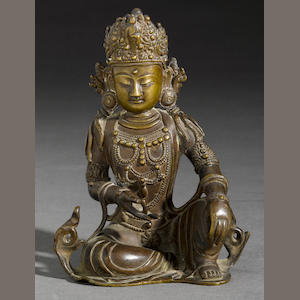 A bronze seated figure of Guanyin Ming dynasty