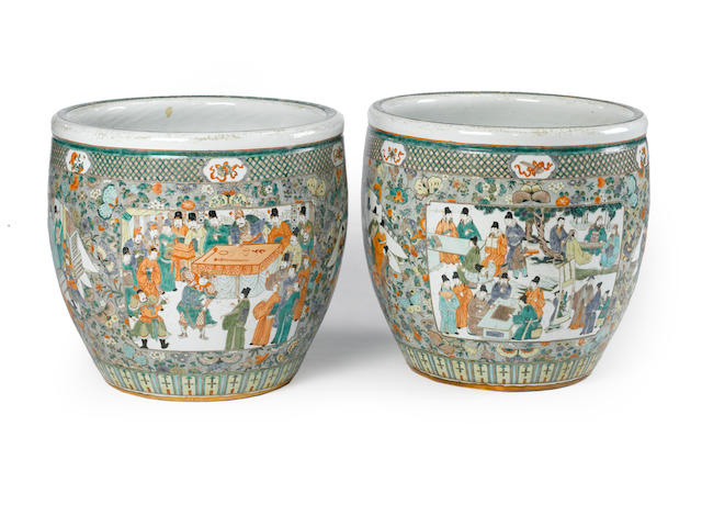 A pair of large famille-verte enameled porcelain fish bowls