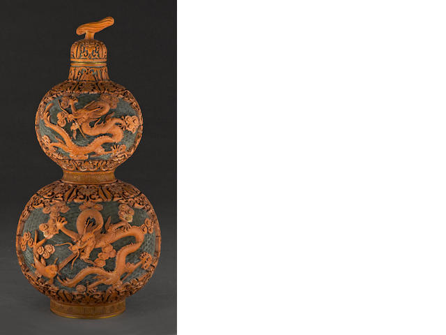 A carved brown lacquer double gourd vase