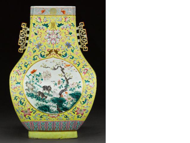 A famille-jaune enameled porcelain hu-form decorated porcelain hu form vase Qianlong mark, Republic period