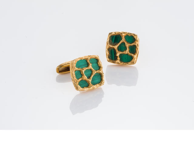 A pair of malachite and eighteen karat gold cufflinks,