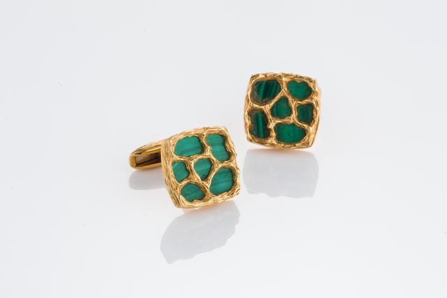 A pair of malachite and eighteen karat gold cufflinks,