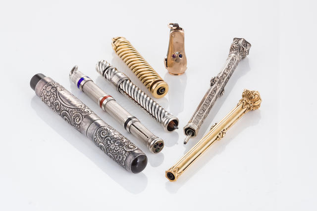 A group of silver and gold accessories