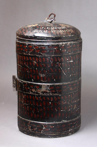 A bearskin busby for the Royal Fusiliers with japanned tin case