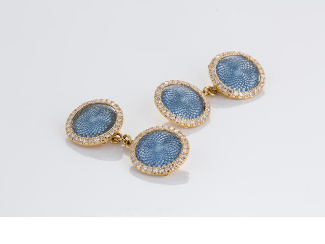 A pair of light blue enamel and diamond cufflinks